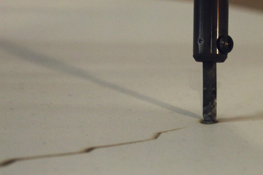 soldering iron scorching C02 data as rings into recycled paper