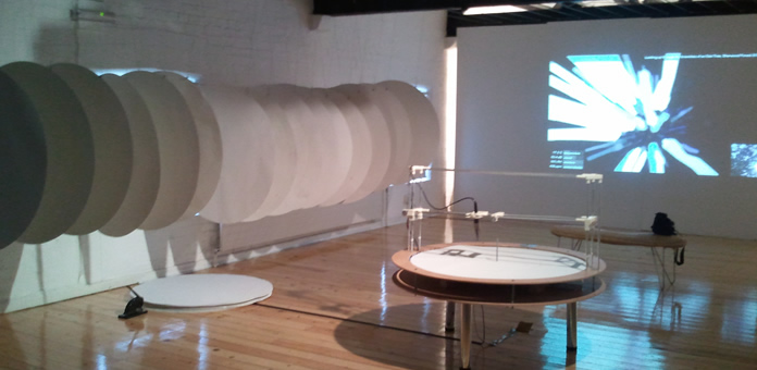 rufford exhibition with machine, sheets and visualisation of oak tree